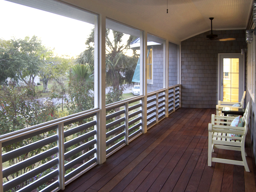 View at front porch in modern vernacular island home
